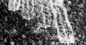 Black and white image of planes dropping agent orange