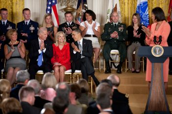 President Barack Obama, First Lady Michelle Obama, and Vice President Joe Biden acknowledge Dr. Jill Biden during the launch of the Joining Forces initiative to support and honor America's service members and their families, in the East Room of the White House April 12, 2011. (Official White House Photo by Lawrence Jackson)