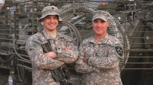 Two white male soldiers with arms folded posing for the picture