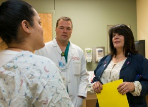 Image: VA medcial staff talk with a female Veteran.