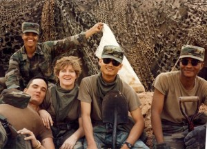 Image of a mid 90ies squad of soldiers relaxing.