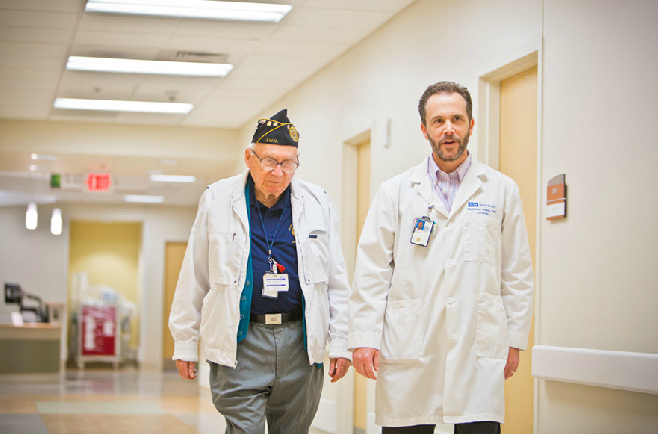 doctor walking with a veteran