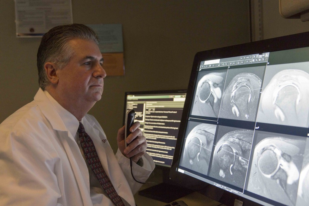 man looking at medical info on computer