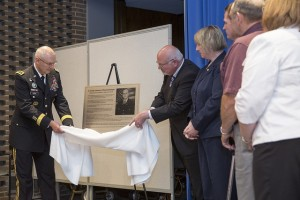 Lt. Gen. Michael Tucker, First Army commanding officer, and Robert Beller, Milwaukee VA medical center director, unveil the permanent memorial to Russell Seager that will hang in the Red Clinic where he worked.