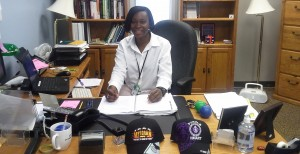 Danielle Green sits at her desk