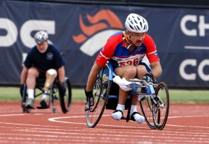 men racing in wheelchairs around a track