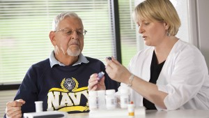 A veteran sits with a doctor