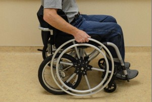 A wheelchair with a man sitting in it.