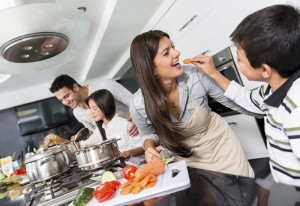 Happy family cooking together and having fun