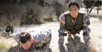 image of male and female Army Soldiers doing push-ups.