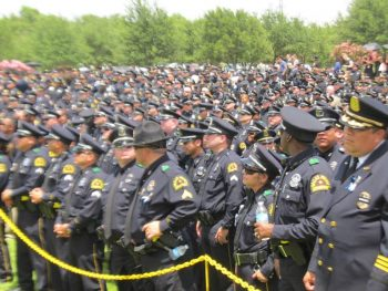 A sea of police offices attend the funeral of slain police officer killed in Dallas attacks.