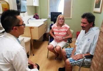 Former U.S. Navy rescue diver Peter Harbachuck and his wife Annie visit with Dr. Joseph Hong, Hepatology Pharmacy Program Manager, at the C.W. Bill Young VA Medical Center. Peter is one of about 1,000 Veterans treated by the Bay Pines VA Healthcare System who have been effectively cured of Hepatitis C due to new treatment options.
