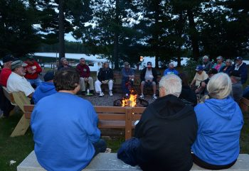 Veterans with diabetes sitting around camp fire