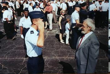 Air Force Veteran George Bishop salutes his son Jeff shortly after his commissioning as a 2nd Lt.