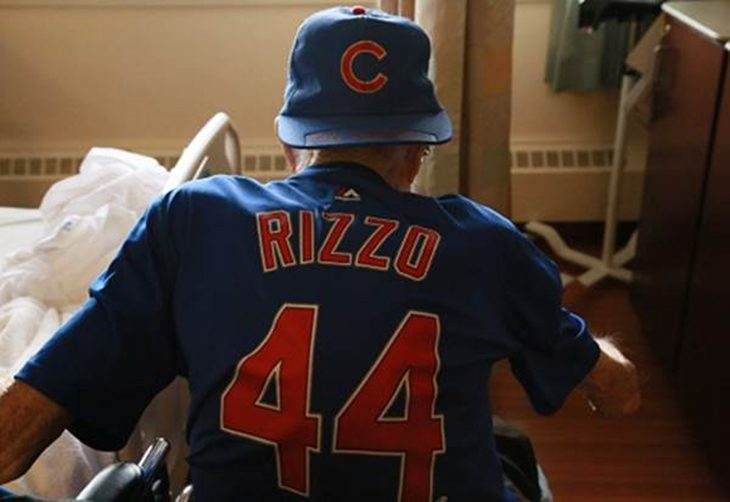 Robert Perkins show's off his Chicago Cubs Rizzo jersey