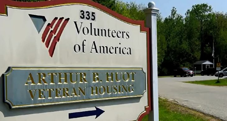 image of a Volunteers of America sign pointing to tranisitonal housing