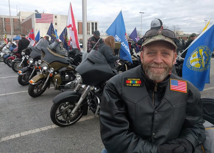 A Veteran sits on his bike in front of the Dorn VAMC