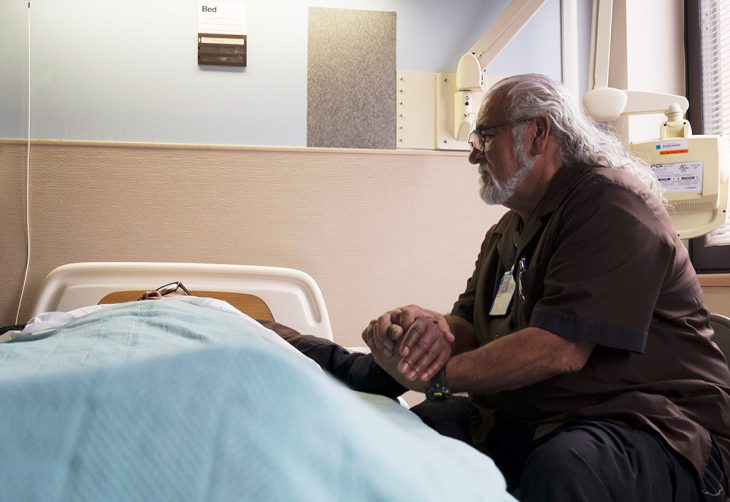 Images of Julian Scadden at the bedside of a dying Veteran