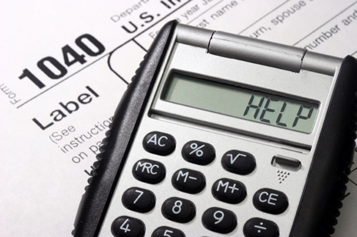 Image of a tax form and a calculator