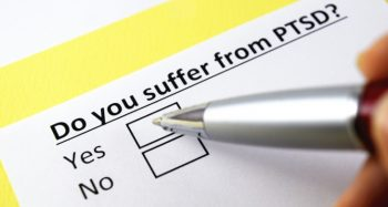 "Image with the test ""Do you suffer from PTSD"" followed by two boxes marked ""yes"" and ""no."""