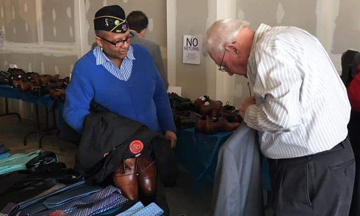 Image of an older Veteran trying on a suit jacket.