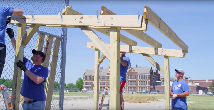 image of Veteran building a wood structure