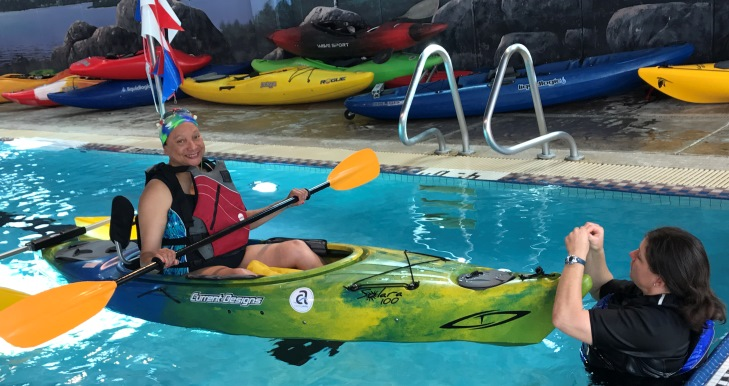 Image of Air Force Veteran Hope Cooper kayaking at the National Disabled Veterans Winter Sports Clinic.