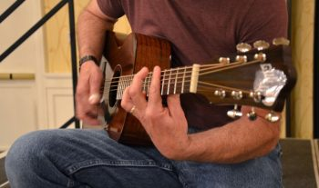 image of a man playing a guitar