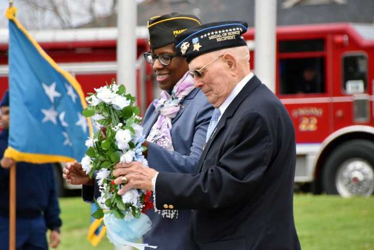 Kentucky Lt. Governor Jenean Hampton and Medal of Honor recipient Woody Williams present a wreath at a ceremony dedicating a Gold Star Families memorial in Lexington, Kentucky.