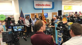 Image: News Media cameras capture the announcement at a local MinuteClinic.
