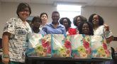 IMAGE: Hampton Home Telehealth staff give back to the community through donations to a local women's shelter. Pictured (l-r) are: Janie Millete, Queen Berger, Mary Haagenson, Ruby Franklin, Jane Curtis, Frances Reid, Latashia Newsome, and Lisa Mercer