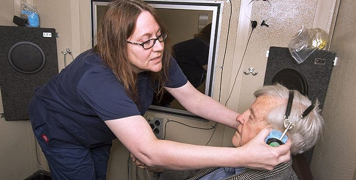 Image: A VA technician performs a hearing test with a Veteran.