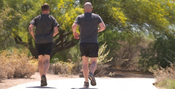 Image of two men in PT gear running on a trail