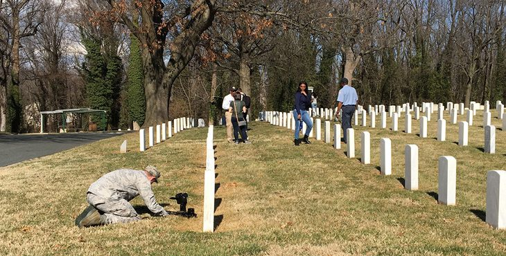 Image: military members shooting video at a VA national cemetery