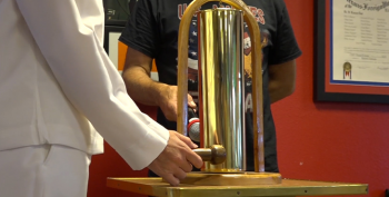 IMAGE: A brass bell, made from a shell casing, is rung in honor of Veterans lost to suicide.