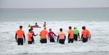 Image: Volunteers teaching Veterans to surf at VA's Summer Sports Clinic.