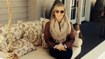 Erin, sitting on outdoor couch on porch, has a passion for realty.
