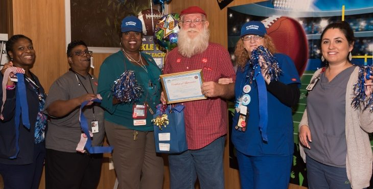 Image: VA North Texas Veteran patient, Jim Boltin, was the recipient of the 10,000th flu vaccine during October's Influenza Awareness Month.