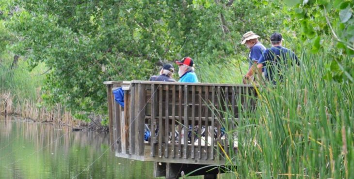 IMAGE: Arsenal Anglers volunteers and veterans immerse themselves in the refuge's calming natural surroundings.