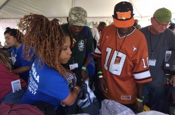 IMAGE: Veterans lined up to get clothes and hygiene bags at the stand down operation rebound. Veterans canteen service donated 18 pallets Of beautiful clothes.