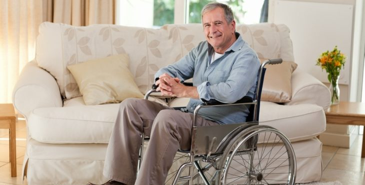 IMAGE: A man in a wheelchair in his living room.