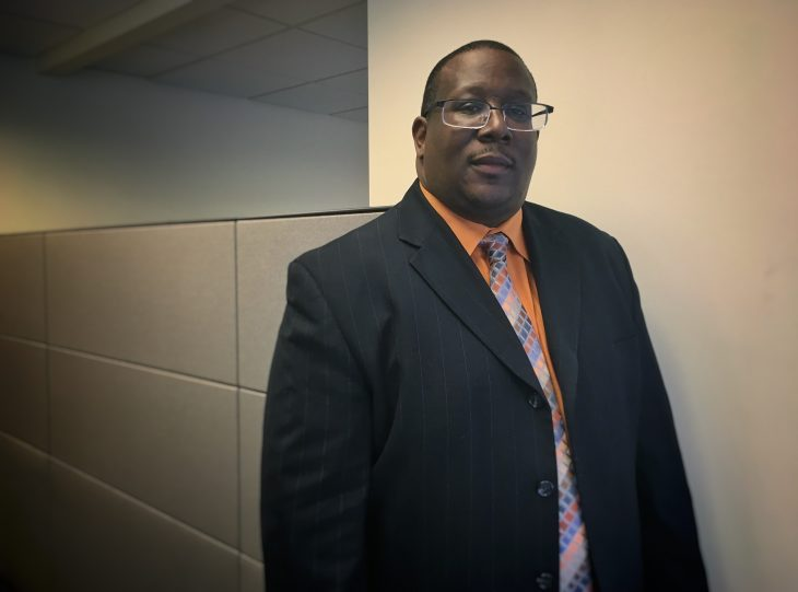 picture of Robert standing in office