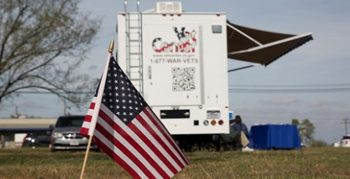 Image: A small U.S. flag planted near a mobile Vet Center that deployed to assist shooting victims and family members.