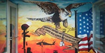 IMAGE: A paining on the Newby-ginnings building featuring an owl carrying dog tags