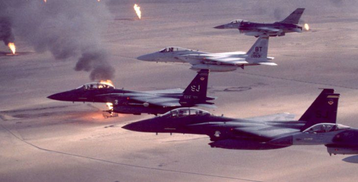 Image: US aircraft fling over burning oil well during the first Gulf War.
