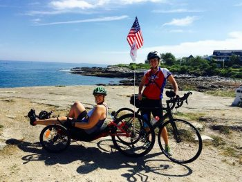 Mary Torczon (L) and Jennifer Weatherford on the shores of the Atlantic Ocean during the Maine Lighthouse Ride in Portland, Maine.