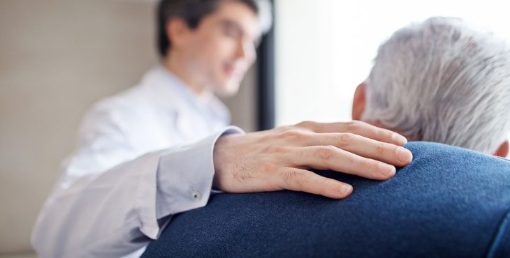 IMAGE: Stock photo of a hand on a shoulder