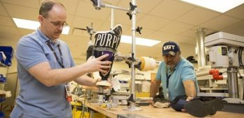 Prosthetic and Sensory Aids Service team members Claude St. Pierre and Juan Montelongo for work inside the prosthetic lab located inside the VA Health Care Center at Harlingen, Jan. 24, 2018. (U.S. Department of Veterans Affairs photo/Luis H. Loza Gutierrez)