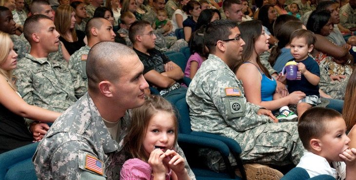 IMAGE: Soldiers attend a briefing with their families.