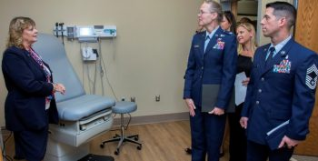 IMAGE: Gulf Coast Veterans Health Care System Nurse Manager Hope Summers explains a new primary care exam room setup to Air Force Colonel Pamela Smith, Eglin Air Force Base's 96th Medical Group commander (middle), Air Force Chief Master Sgt. Scott Super, Eglin Air Force Base's 96th Medical Group acting superintendent and others during a tour of the Eglin AFB VA clinic expansion ribbon cutting ceremony April 26.
